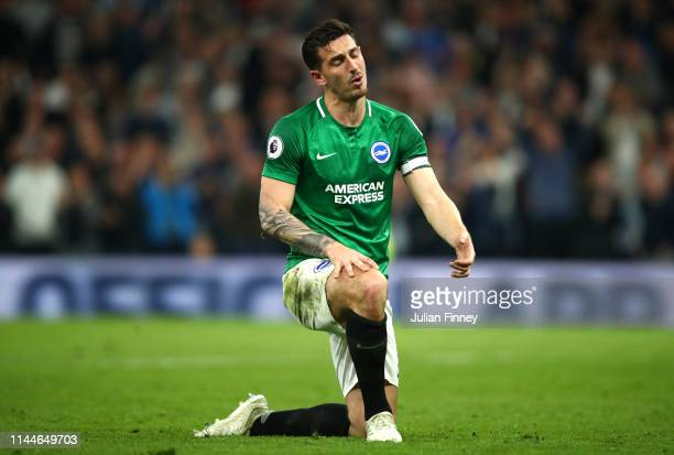 Lewis Dunk of Brighton and Hove Albion looks dejected after his team concede during the Premier League match between Tottenham Hotspur and Brighton...