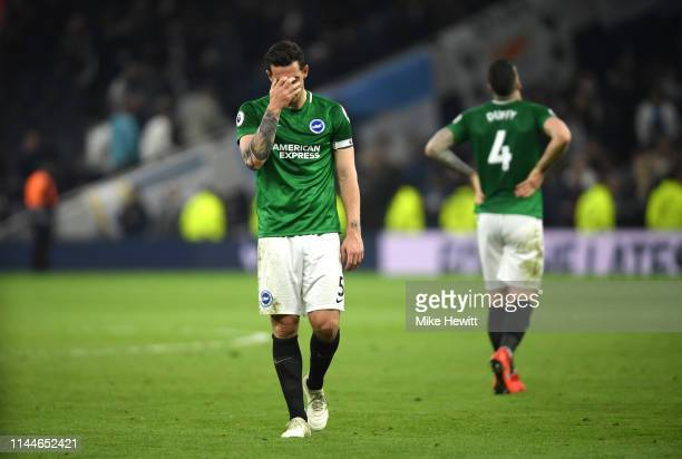 Lewis Dunk of Brighton and Hove Albion looks dejected following his sides defeat in the Premier League match between Tottenham Hotspur and Brighton...