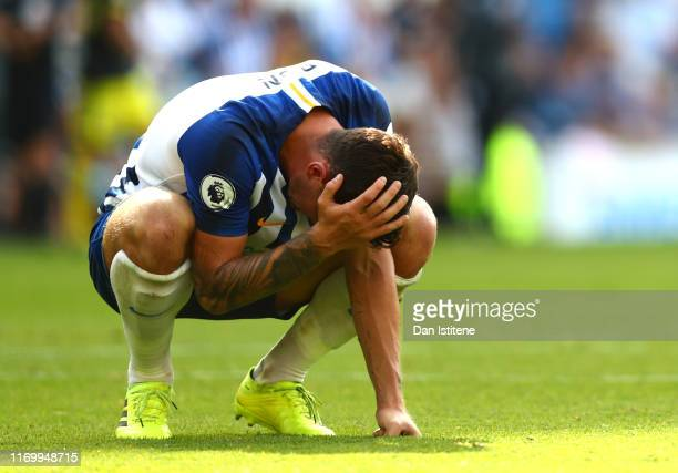 Lewis Dunk of Brighton and Hove Albion looks dejected following his sides defeat in the Premier League match between Brighton Hove Albion and...