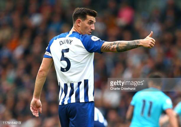 Lewis Dunk of Brighton and Hove Albion reacts during the Premier League match between Brighton Hove Albion and Tottenham Hotspur at American Express...