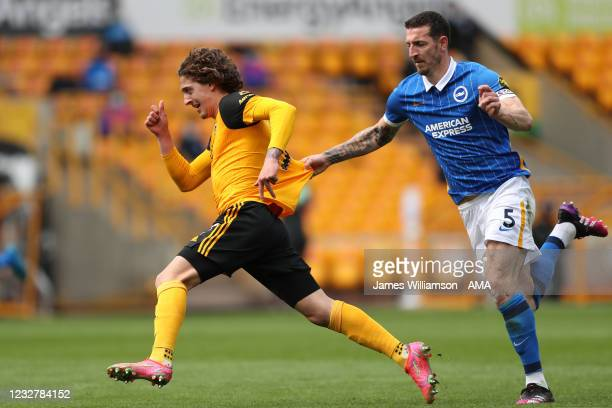 Lewis Dunk of Brighton and Hove Albion recieves a red card for a tackle on Fabio Silva of Wolverhampton Wanderers during the Premier League match...
