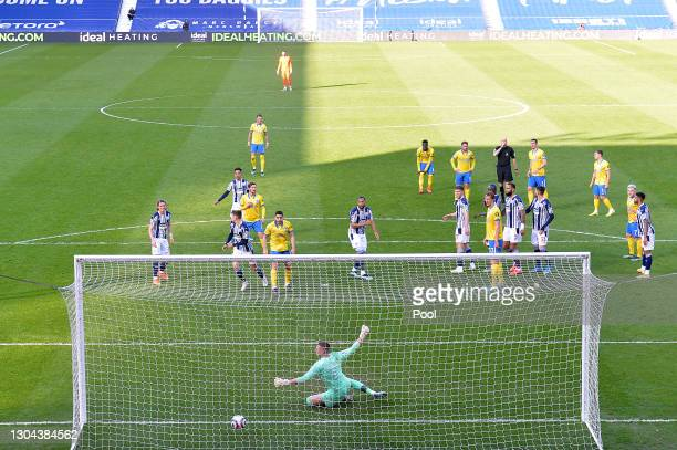 Lewis Dunk of Brighton and Hove Albion scores a goal past Sam Johnstone of West Bromwich Albion from a quickly taken free kick, which causes much...