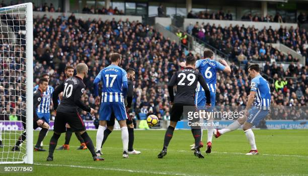 Lewis Dunk of Brighton and Hove Albion scores his sides first goal during the Premier League match between Brighton and Hove Albion and Arsenal at...