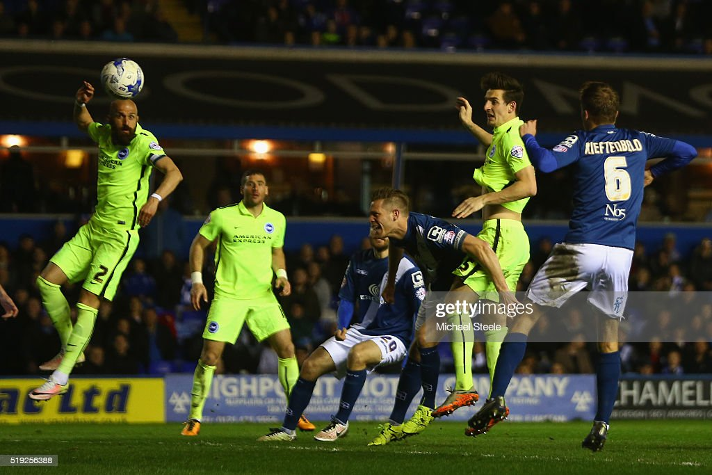 Lewis Dunk (2R) of Brighton and Hove Albion scores his sides second goal during the Sky Bet Championship match between Birmingham City and Brighton and Hove Albion at St Andrews on April 5, 2016 in Birmingham, United Kingdom.