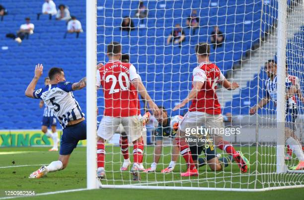 Lewis Dunk of Brighton and Hove Albion scores his team's first goal during the Premier League match between Brighton & Hove Albion and Arsenal FC at...