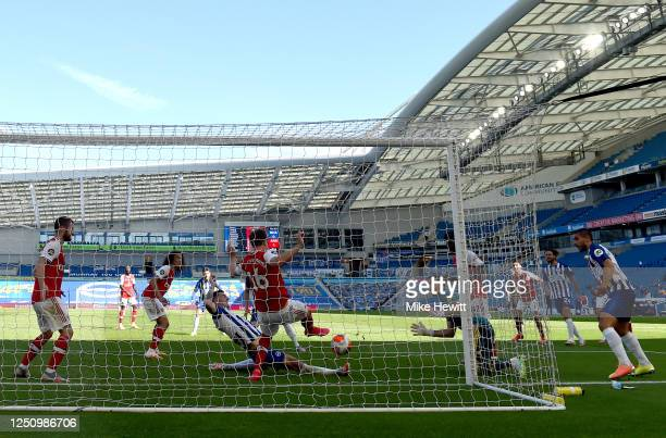 Lewis Dunk of Brighton and Hove Albion scores his team's first goal during the Premier League match between Brighton Hove Albion and Arsenal FC at...