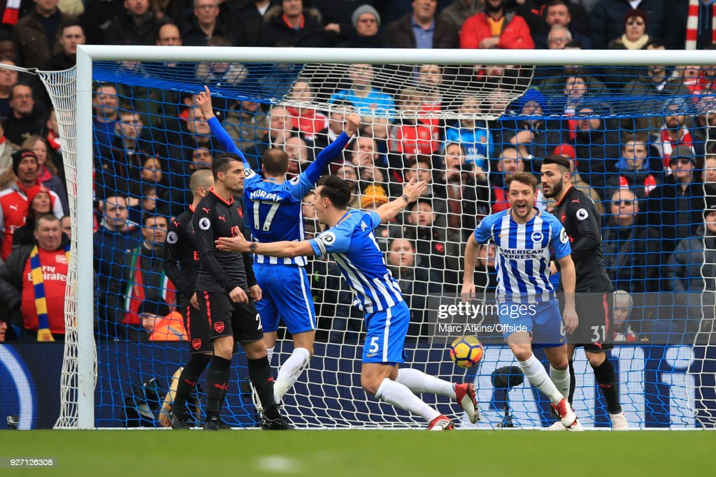 Lewis Dunk of Brighton and Hove Albion scores their 1st goal during the Premier League match between Brighton and Hove Albion and Arsenal at Amex Stadium on March 4, 2018 in Brighton, England.