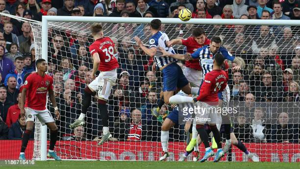 Lewis Dunk of Brighton and Hove Albion scores their first goal during the Premier League match between Manchester United and Brighton Hove Albion at...