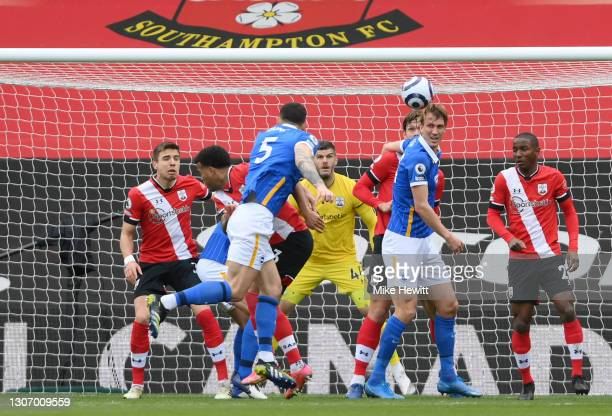 Lewis Dunk of Brighton and Hove Albion scores their side's first goal past Fraser Forster of Southampton during the Premier League match between...