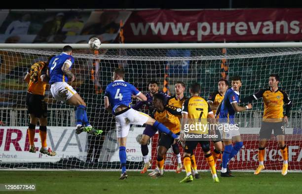 Lewis Dunk of Brighton and Hove Albion wins a header under pressure from Mickey Demetriou of Newport County during the FA Cup Third Round match...