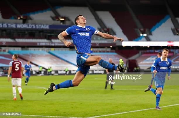 Lewis Dunk of Brighton & Hove Albion celebrates after scoring their team's second goal during the Premier League match between West Ham United and...