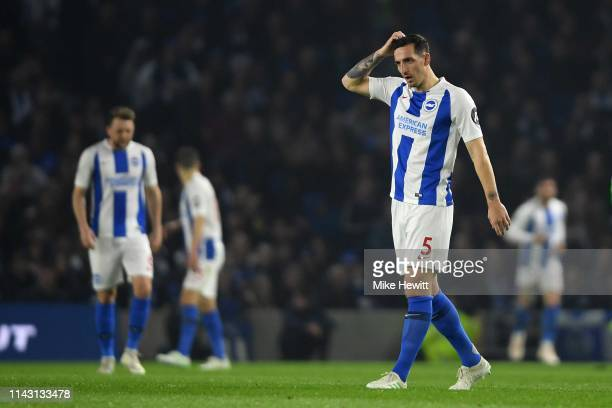 Lewis Dunk of Brighton Hove Albion cuts a dejected figure during the Premier League match between Brighton Hove Albion and Cardiff City at American...