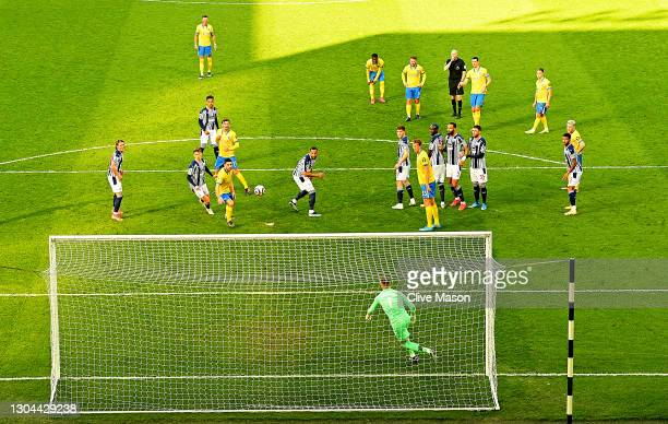 Lewis Dunk of Brighton & Hove Albion takes a free kick as referee Lee Mason blows the whistle. The free kick led to a goal, then following a VAR...