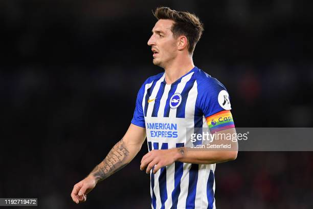 Lewis Dunk of Brighton Hove Albion wears the stonewall rainbow laces captains armband during the Premier League match between Brighton Hove Albion...