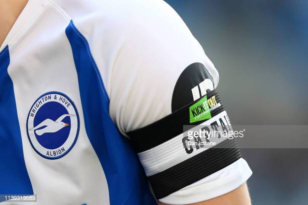 Lewis Dunk of Brighton Hove Albion's captain's armband displaying the Kick It Out campaign logo during the Premier League match between Brighton Hove...