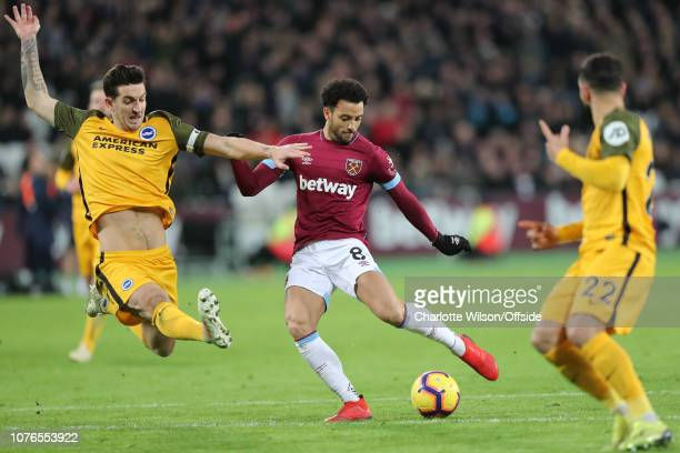 Lewis Dunk of Brighton stretches for the ball but Felipe Anderson of West Ham shoots past him during the Premier League match between West Ham United...