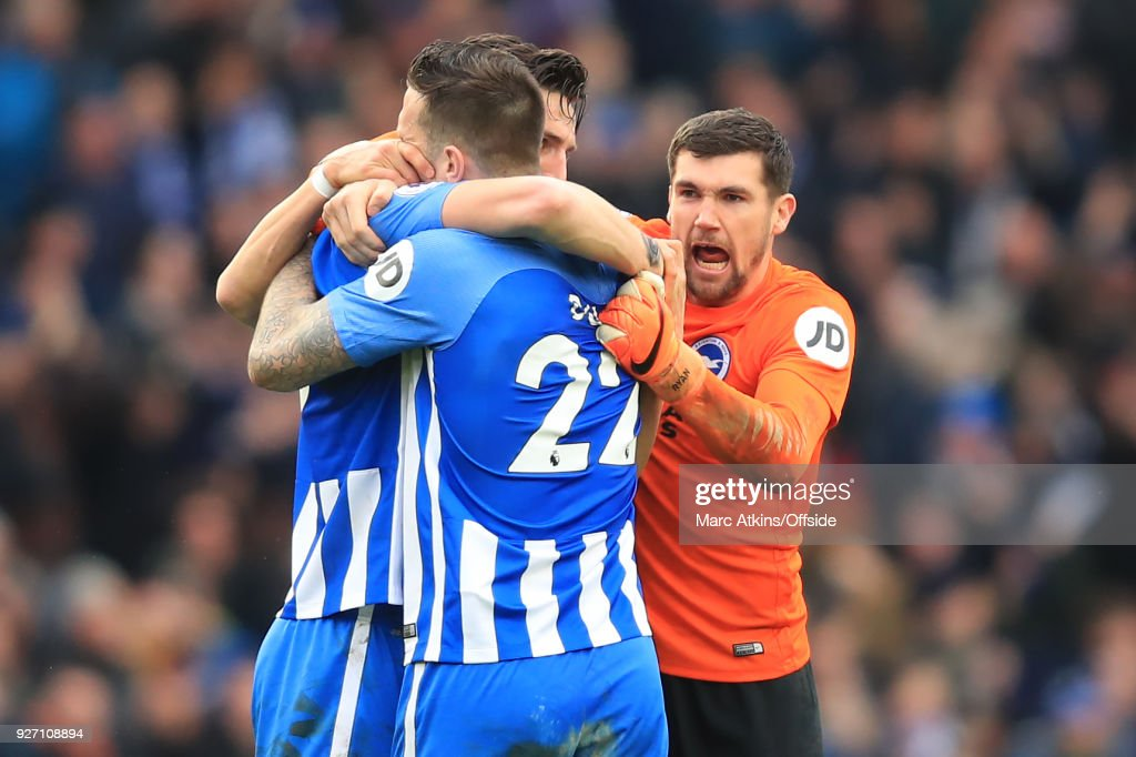 Lewis Dunk, Shane Duffy and Matthew Ryan of Brighton and Hove Albion celebrate during the Premier League match between Brighton and Hove Albion and Arsenal at Amex Stadium on March 4, 2018 in Brighton, England.