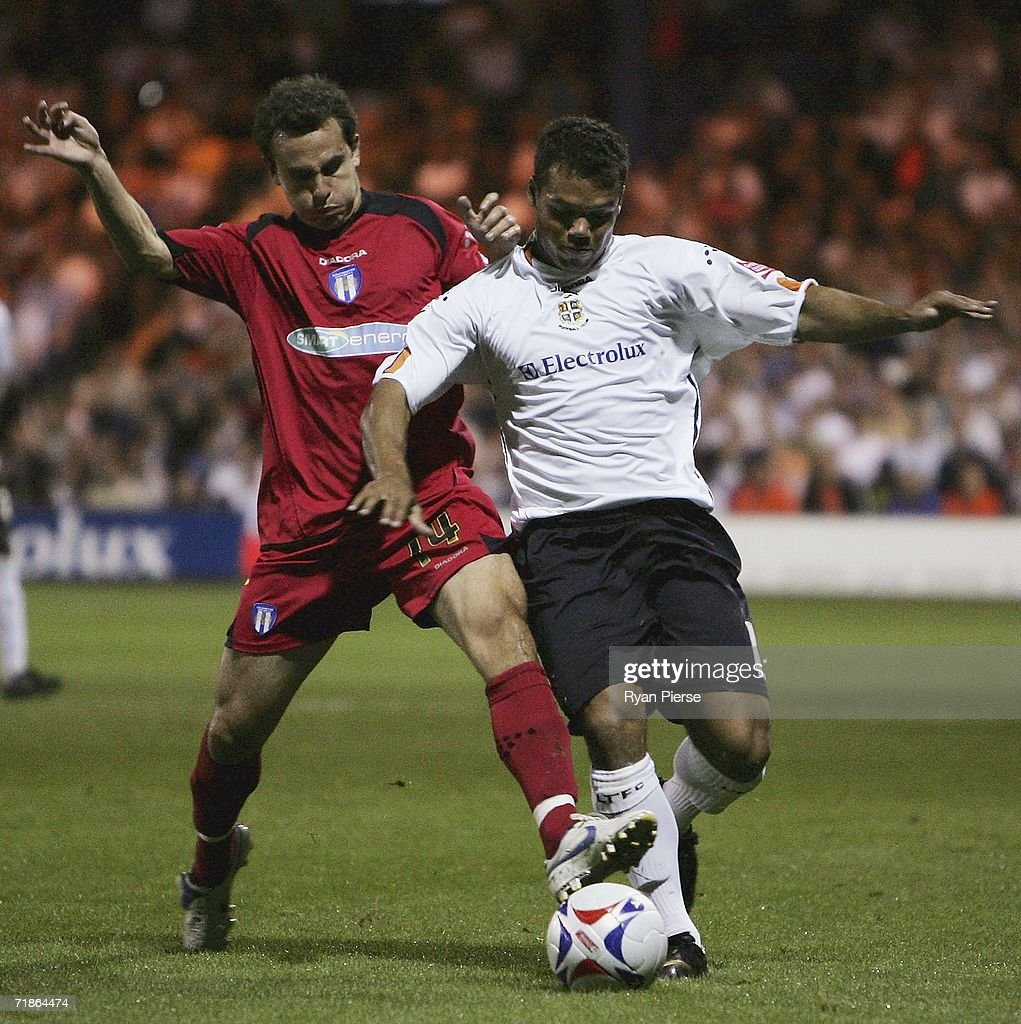 Lewis Emanuel (R) of Luton Town is tackled by Richard Garcia (L) of Colchester United during the Coca Cola Championship match between Luton Town and Colchester United at Kenilworth Road on September 12, 2006 in Luton, England.