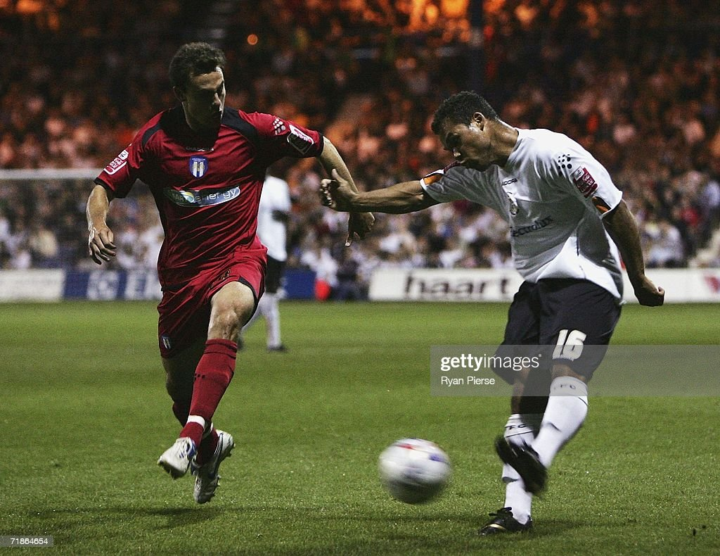 Lewis Emanuel (R) of Luton Town kicks past Richard Garcia (L) of Colchester United during the Coca Cola Championship match between Luton Town and Colchester United at Kenilworth Road on September 12, 2006 in Luton, England.