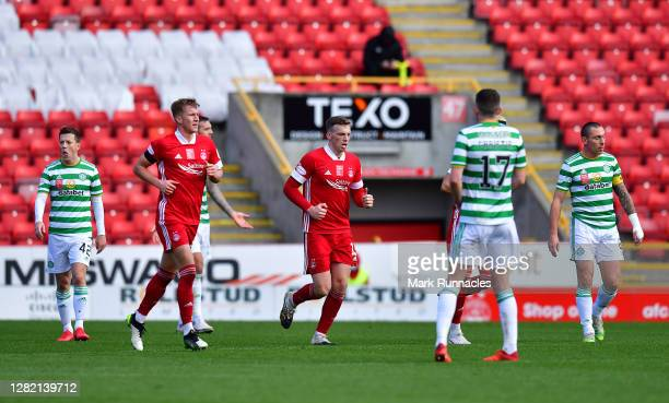 Lewis Ferguson of Aberdeen celebrates after scoring his team's third goal from a penalty during the Ladbrokes Scottish Premiership match between...