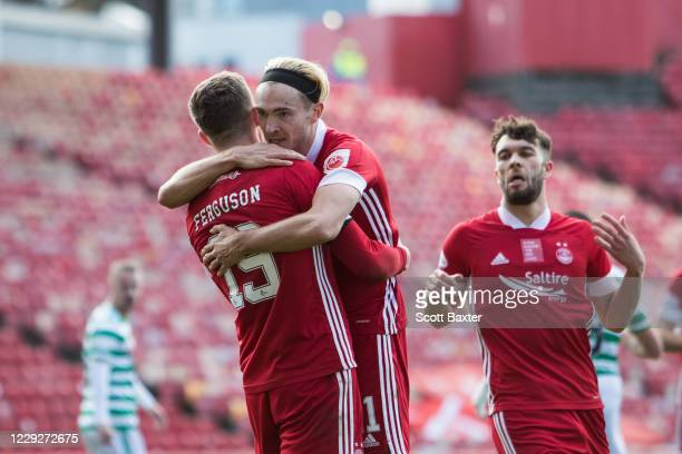 Lewis Ferguson of Aberdeen celebrates with Ryan Hedges during the Ladbrokes Premiership match between Aberdeen and Celtic at Pittodrie Stadium on...