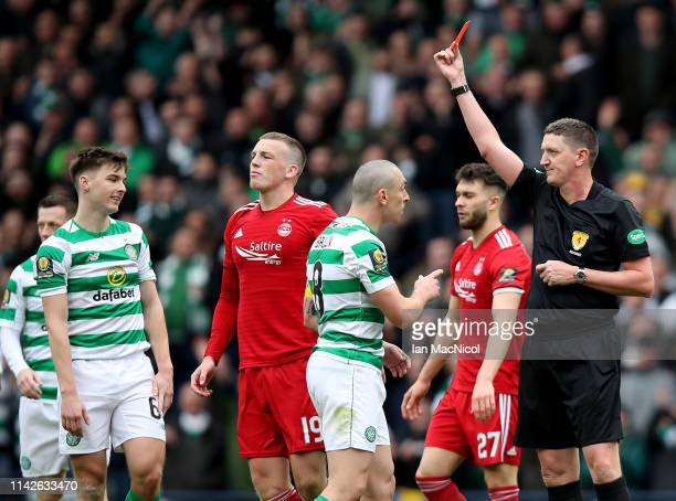 Lewis Ferguson of Aberdeen is sent off after his challenge on Tomas Rogic of Celtic during the Scottish Cup semifinal between Aberdeen and Celtic at...