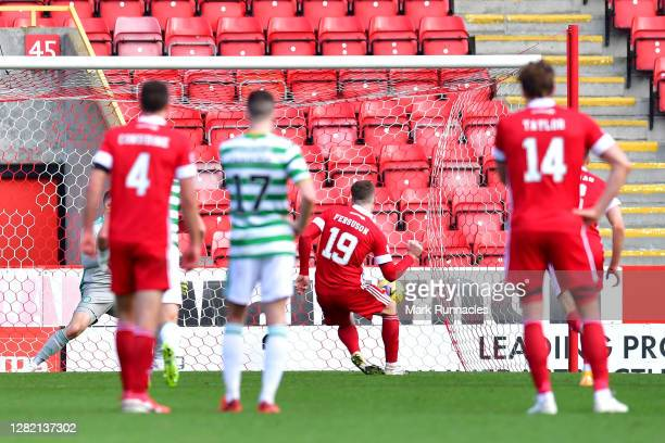 Lewis Ferguson of Aberdeen scores his team's third goal from a penalty during the Ladbrokes Scottish Premiership match between Aberdeen and Celtic at...