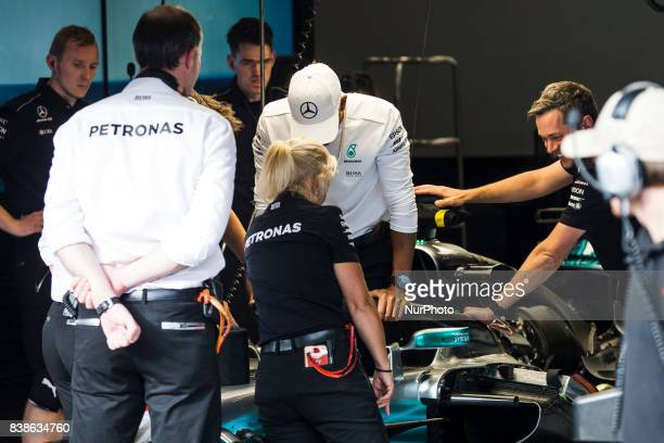 Lewis from Great Britain of team Mercedes GP testing how to get out the car with the Halo during the Formula One Belgian Grand Prix at Circuit de...