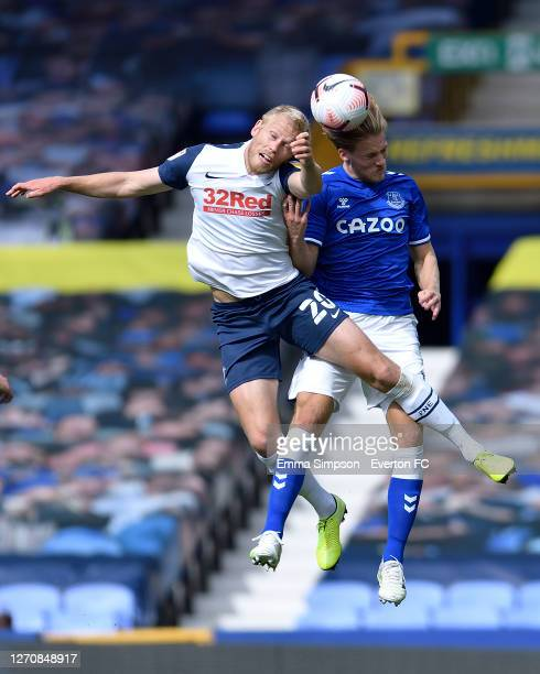Lewis Gibson of Everton challenges Jayden Stockley of Preston for the ball during the PreSeason Friendly match between Everton and Preston North End...