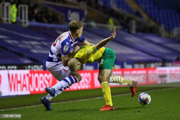 Lewis Gibson of Reading FC and Teemu Pukki of Norwich City battle for the ball during the Sky Bet Championship match between Reading and Norwich City...