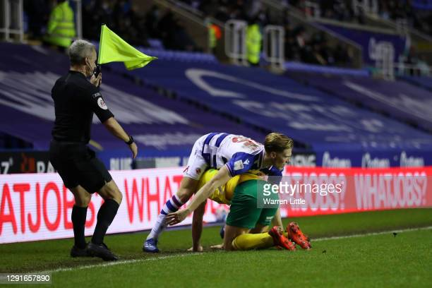 Lewis Gibson of Reading FC and Teemu Pukki of Norwich City clash during the Sky Bet Championship match between Reading and Norwich City at Madejski...