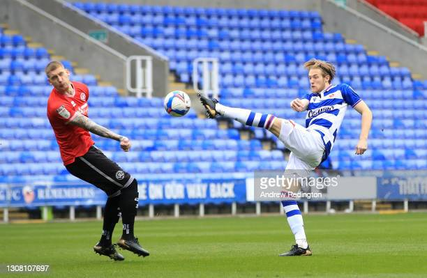 Lewis Gibson of Reading FC is closed down by Jordy de Wijs of Queens Park Rangers during the Sky Bet Championship match between Reading and Queens...