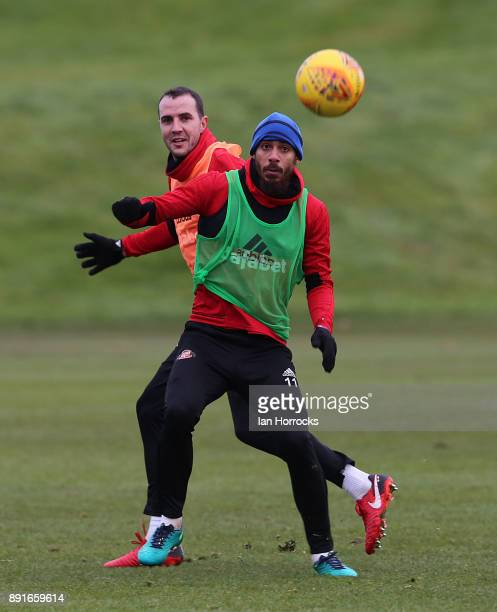 Lewis Grabban controls the ball ahead of John O'Shea during a Sunderland training session at The Academy of Light on December 13 2017 in Sunderland...