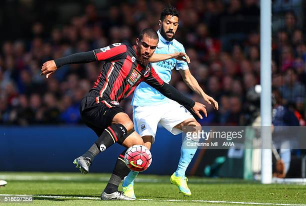 Lewis Grabban of Bournemouth and Gael Clichy of Manchester City during the Barclays Premier League match between AFC Bournemouth and Manchester City...