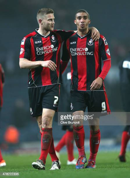 Lewis Grabban of Bournemouth celebrates at the final whistle with team mate Simon Francis after scoring the winning goal during the Sky Bet...