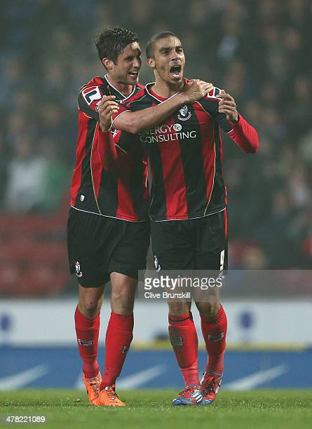 Lewis Grabban of Bournemouth celebrates with a team mate Andrew Surman after scoring the first goal during the Sky Bet Championship match between...