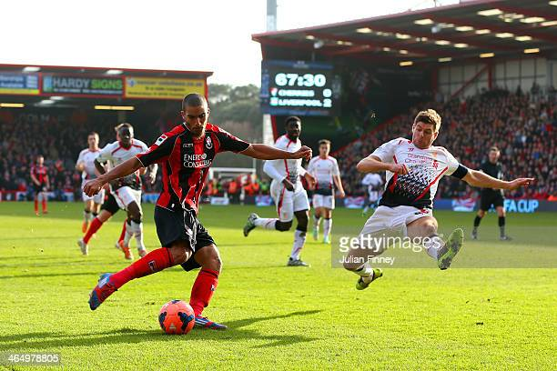 Lewis Grabban of Bournemouth crosses the ball as Steven Gerrard of Liverpool attempts the block during the FA Cup Fourth Round match between...