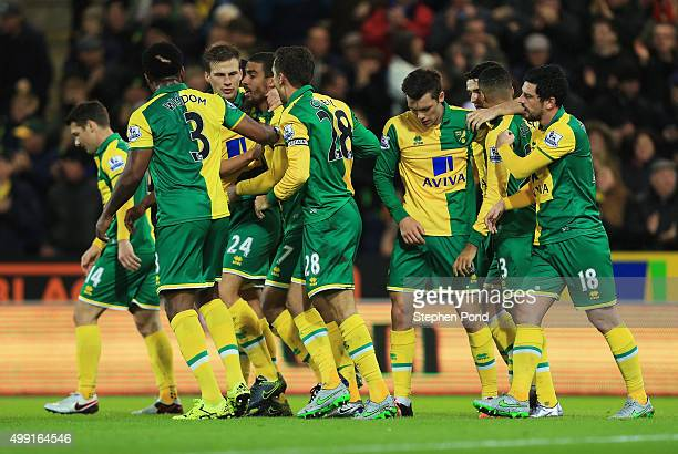 Lewis Grabban of Norwich City celebrates team mates as he scores their first and equalising goal during the Barclays Premier League match between...
