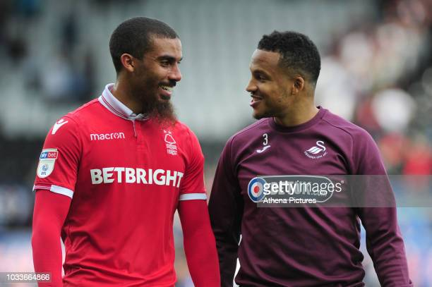 Lewis Grabban of Nottingham Forest and Martin Olsson of Swansea City share a joke at full time of the Sky Bet Championship match between Swansea City...