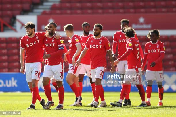 Lewis Grabban of Nottingham Forest celebrates with teammates after scoring their team's second goal during the Sky Bet Championship match between...
