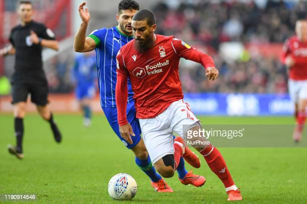 Lewis Grabban of Nottingham Forest holds off Sam Morsy of Wigan Athletic during the Sky Bet Championship match between Nottingham Forest and Wigan...