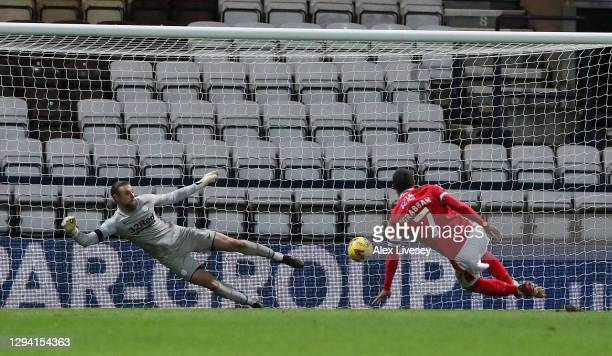 Lewis Grabban of Nottingham Forest scores from the penalty spot for his team's first goal during the Sky Bet Championship match between Preston North...