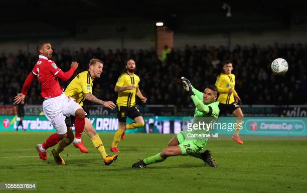 Lewis Grabban of Nottingham Forest scores his team's first goal past Dimitar Evtimov of Burton Albion during the Carabao Cup Fourth Round match...