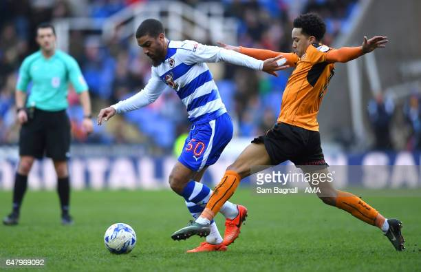 Lewis Grabban of Reading and Helder Costa of Wolverhampton Wanderers during the Sky Bet Championship match between Reading and Wolverhampton...
