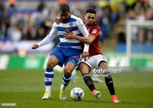 Lewis Grabban of Reading and Ryan Fredericks of Fulham battle for possession during the Sky Bet Championship Play Off Second Leg match between...