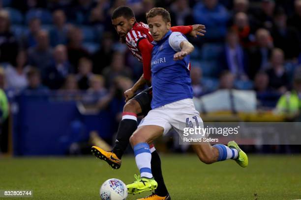 Lewis Grabban of Sunderland and Almen Abdi of Sheffield Wednesday in action during the Sky Bet Championship match between Sheffield Wednesday and...