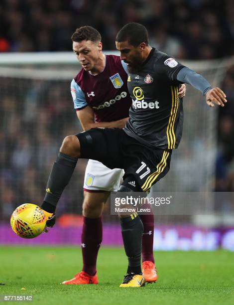 Lewis Grabban of Sunderland and James Chester of Aston Villa challenge for the ball during the Sky Bet Championship match between Aston Villa and...