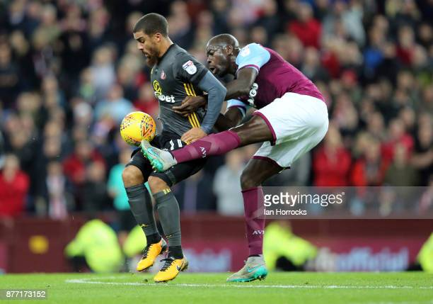 Lewis Grabban of Sunderland holds off Chris Samba of Villa during the Sky Bet Championship match between Aston Villa and Sunderland at Villa Park on...