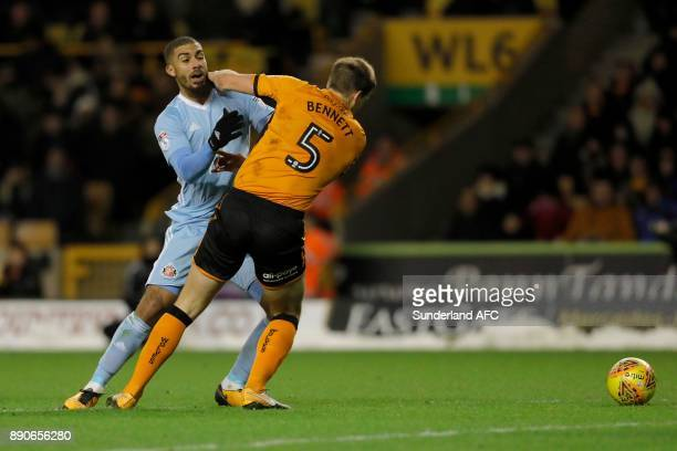Lewis Grabban of Sunderland is blocked by Ryan Bennett of Wolverhampton Wanderers during the Sky Bet Championship match between Wolverhampton and...
