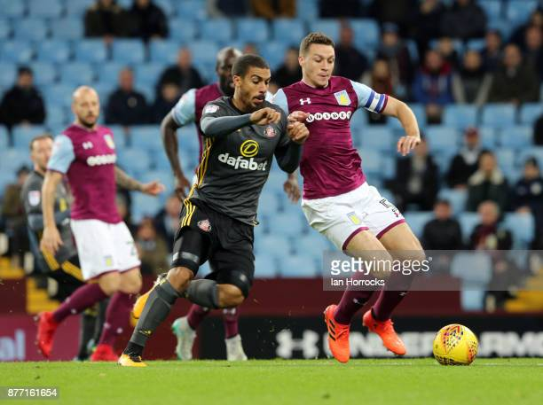 Lewis Grabban of Sunderland is challenged by James Chester of Villa during the Sky Bet Championship match between Aston Villa and Sunderland at Villa...